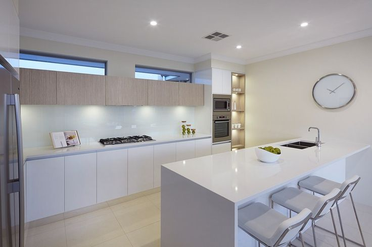 Kitchen features breakfast bar with stone slab end, feature display cabinet, hi lite windows and glass splashback. Find out more here: http://www.redinkhomes.com.au/products/metro/ocean-series/the-milford.aspx