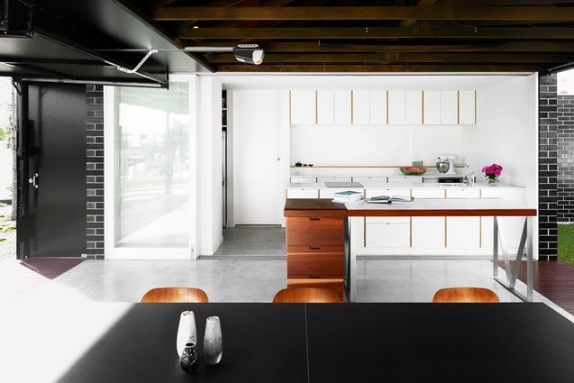 White kitchen meets the brick wall