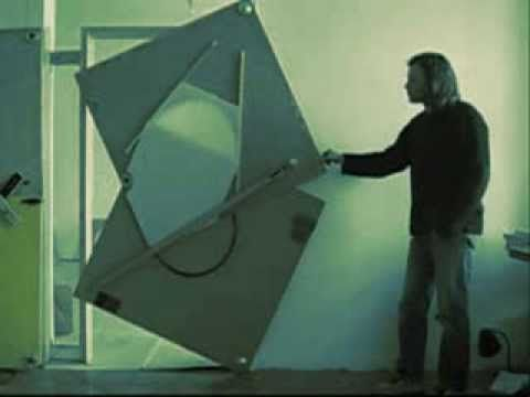 Klemens Torggler's doors are kinetic art objects based on rotating squares. The special invention makes it possible to move the object sideways without the u...