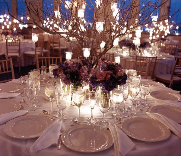 Beautiful tree branch wedding table  centrepiece with hanging candle votives. Would be interested in finding out the origins of the centrepiece and where you can manzanita branches or something similar in Australia which don't costs a fortune