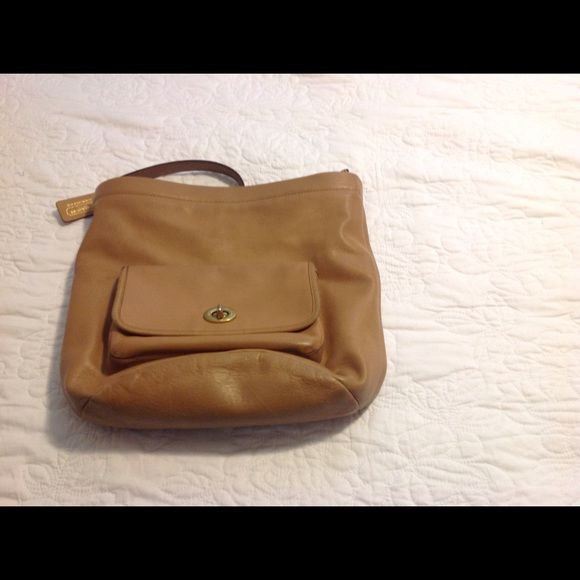 Coach Camel Bag Gently used Coach bag.  Great compartments and classic color that is season less Coach Bags Shoulder Bags