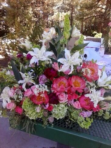 Funeral spray for podium. Lilies, roses, hydrangeas and peonies.