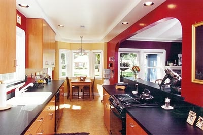 Red Walls + Big Arched Entryway = Kitchen