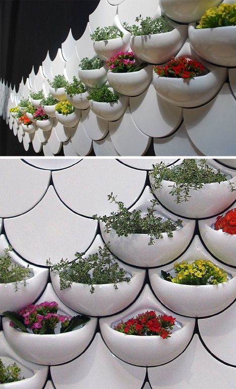 Interactive Wall Tiles serve as planters, shelving and seating