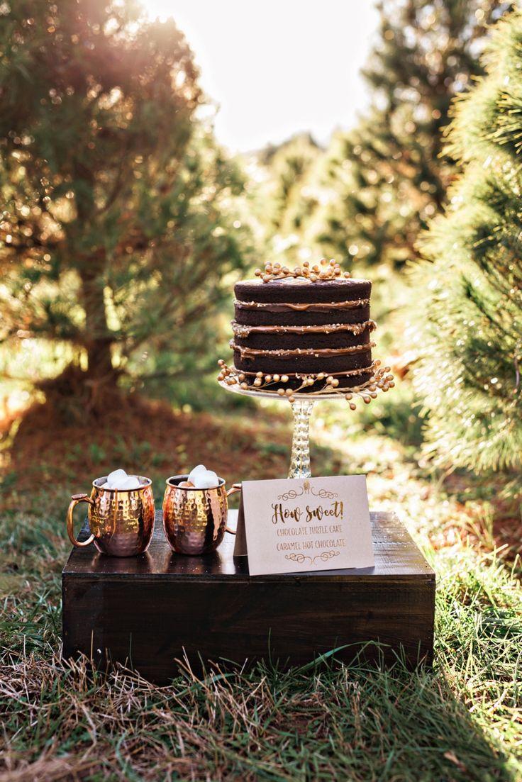Chocolate turtle naked cake with copper mugs and hot chocolate. Winter Christmas Tree Farm Elopement | Amilia Photography | Nashville Wedding Photographer