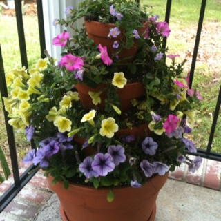 My take on the flower pot tower!  So easy - esp w/plastic containers!