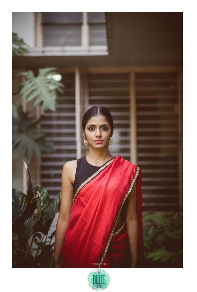 Red linen saree with a stunning yet simple mirror work border. For details,contact- bluedoor.the@gmail.com