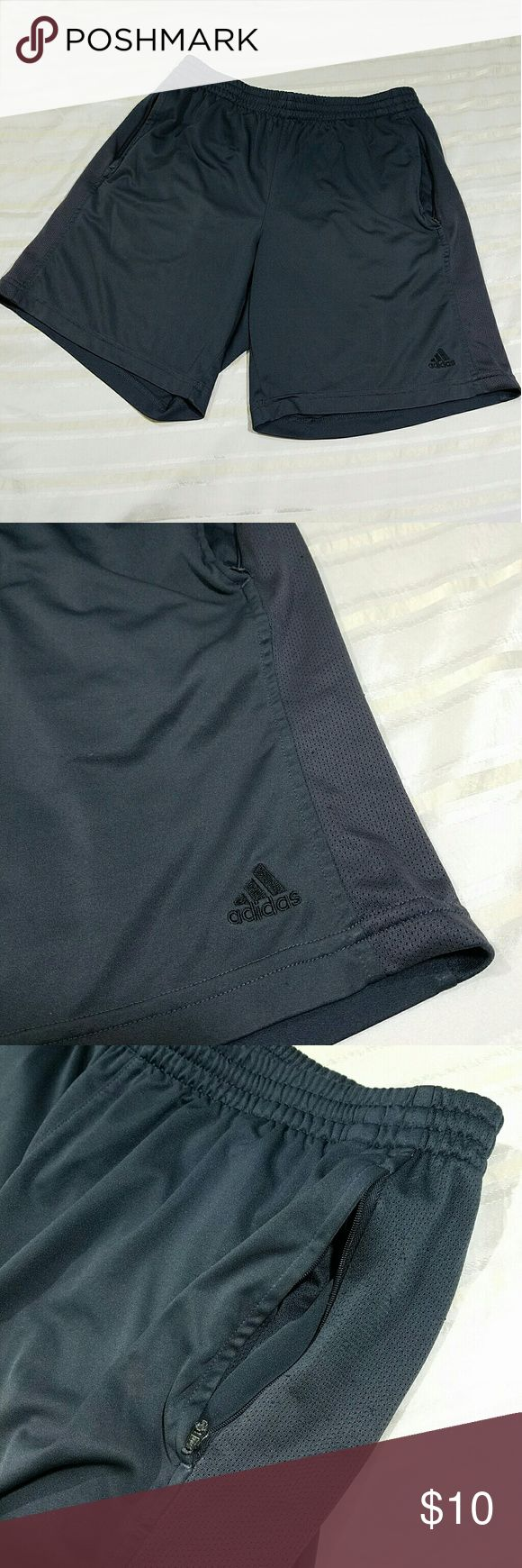 "ADIDAS WORKOUT SHORTS Adidas mens workout shorts. Dark gray mesh material. Has elastic and drawstring band. Black embroidered Adidas logo at bottom of leg.  Is short, mid thigh. Length from top to bottom is 17.5"" has two side pocketsn zippers are stuck and don't work. See photo for detail. Size Medium Adidas Shorts Athletic"