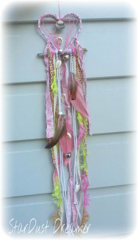 Fluro Boho Heart Funky Retro/ bohemian inspired dream catcher. Hot pink heart with tail woven through natural driftwood with pops of yellow. Earthy feathers and silver bell chain finish of this original piece.