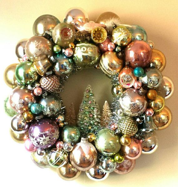 This, one of a kind, heirloom wreath is designed with authentic, vintage glass ornaments in gorgeous pastel, pearly, antique shades. A wonderful,