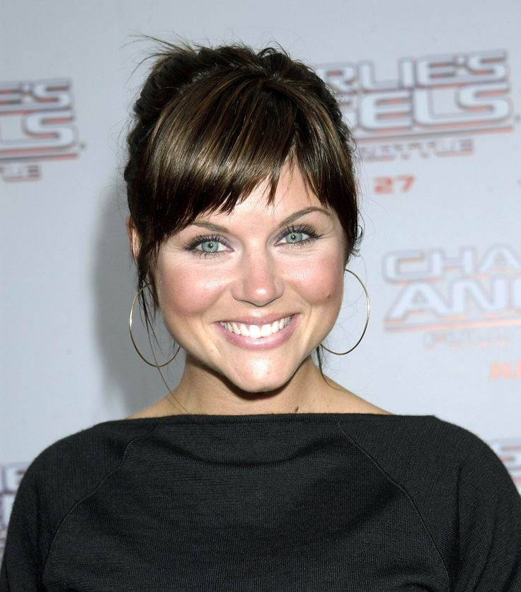 Tiffani Amber Thiessen - cute choppy side bangs.  Definitely my next cut!