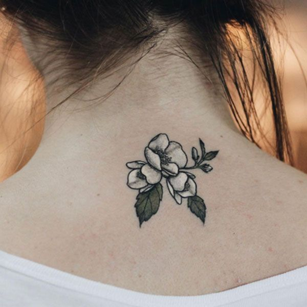 Kendall Jenner may have a white heart on her finger, but we're forever in love with this magnolia, rendered in watercolor white. #refinery29 http://www.refinery29.com/2016/04/109196/watercolor-tattoos#slide-15