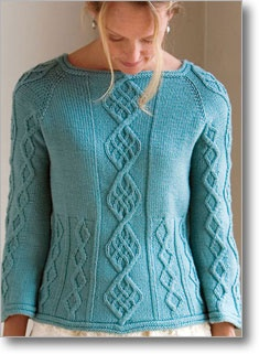A large diamond cable runs down the center of this raglan pullover. It's flanked by smaller, asymmetrical cables that begin at the midriff. This garment is so simple even a beginner can do it.