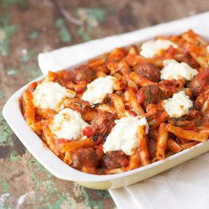 Cheesy Italian Meatball Casserole -- A baked pasta recipe is a surefire crowd pleaser, especially when it's full of Italian meatballs, tangy pasta sauce, and luscious cheeses.