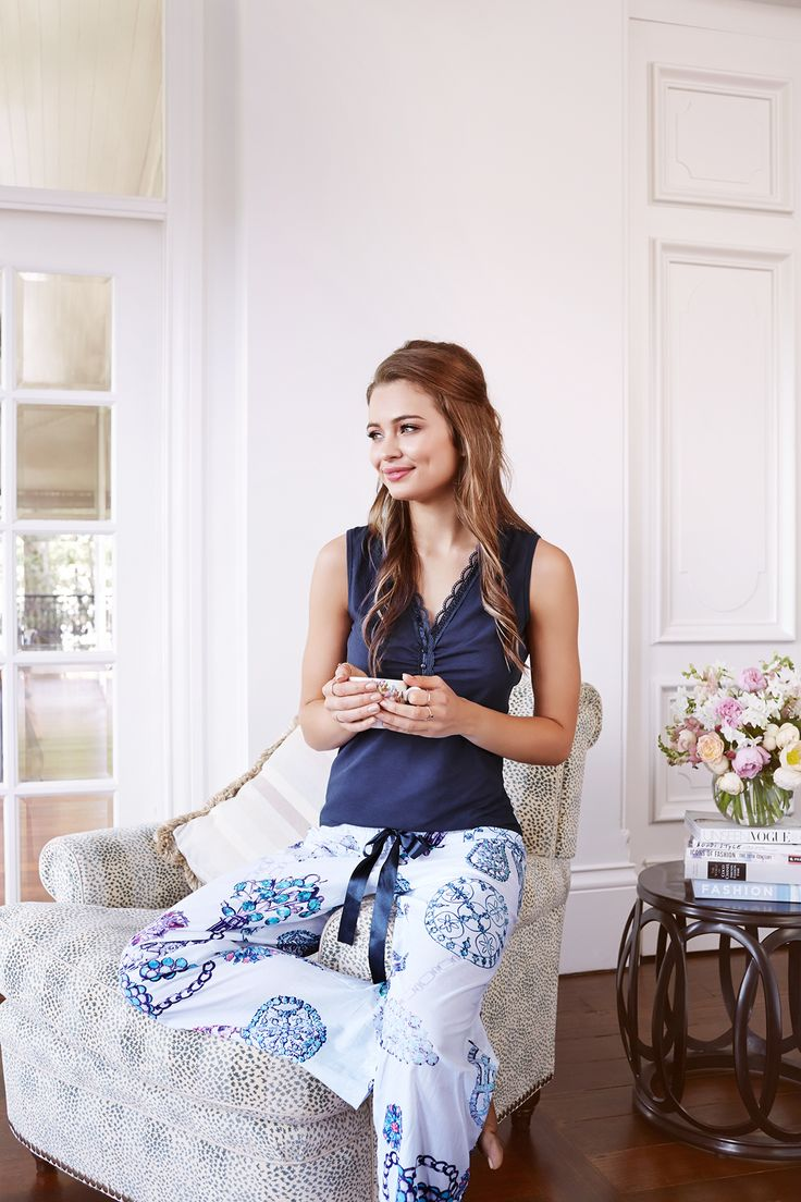 This lovely two-piece set offers an exclusive jewel print pant inspired by Marie-Antoinette's opulence and extravagant taste. A shiny thick ribbon ties elegantly at the waist to offer flexibility and comfort. The modal top is a rich complimentary navy blue that is stretchy and super soft on your skin. The plunging neckline is decorated with buttons and elegant lace. Martine is the perfect set to make you smile while you sleep!  www.gingerlilly.com.au