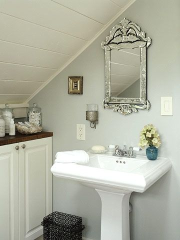 Small Bath: View Two  The vanity fits snugly under the eaves. This slim pedestal sink takes up minimal space, and its simple lines keep the focus on more ornate accessories, like the mirror.