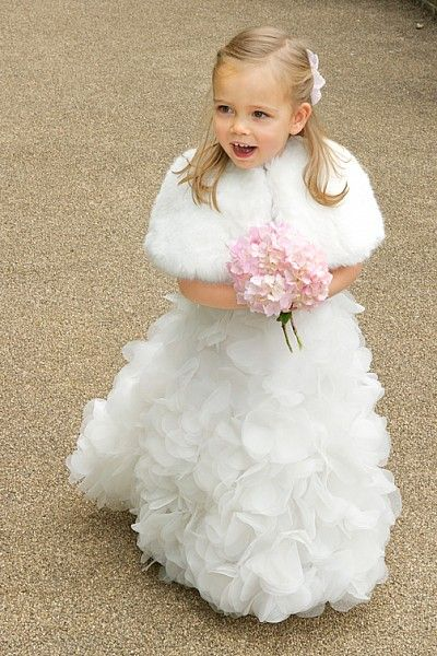 www.handmadeweddings.co.uk This little bridesmaid looks so cute in her faux fur wrap, perfect for a winter wedding