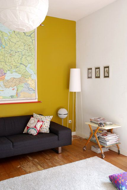 mustard wall & light grey wall with wooden floors!