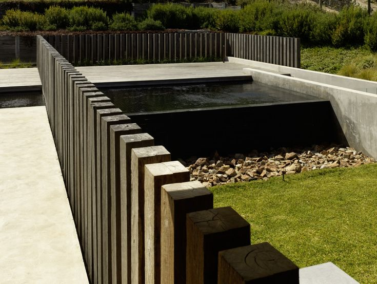 Spotted Gum | Jolson Black tiled plunge pool with infinity edge. Pinned to Pool Design by BASK Pool Design.