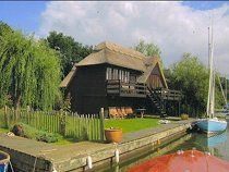 The Norfolk Boathouse - South Walsham, Norfolk Broads -   Wonderful waterside holiday cottage. Classic thatched old Boathouse overlooking South Walsham Broad which has been recently refurbished with stunning views - Sleeps 8 in 3 bedrooms + sofa bed.