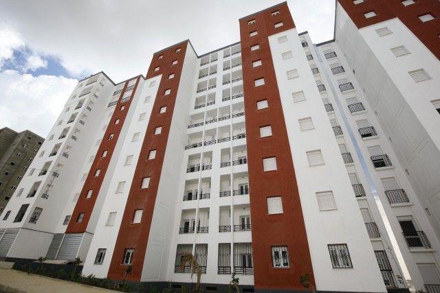 قوانين وأدوات التهيئة العمرانية والتعمير في الجزائر Building Multi Story Building Urban