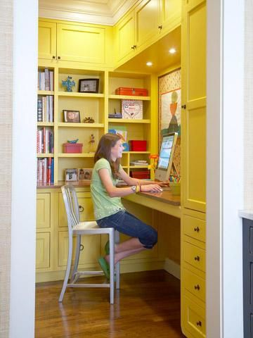 Once the cabinets were installed, Bonnie had a painter apply shades of green (from lime to apple to celery) and yellow (including a black undertone) to achieve more depth and texture from the brushstrokes.  Pictured at left: Built-ins create a computer station/pantry off the kitchen -- great for storing cookbooks and searching online. Benjamin Moore (paint on cabinets, Yellow Rain Coat, No. 2020-40)