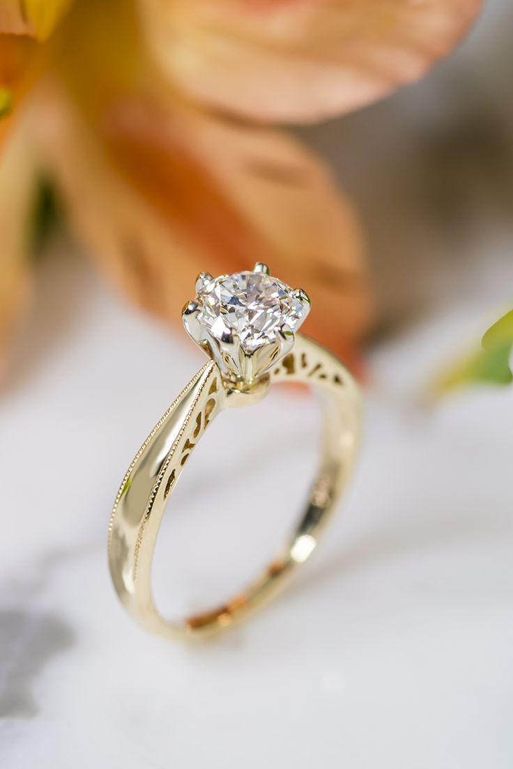 detailed 14k yellow gold engagement ring from @shanecompany!