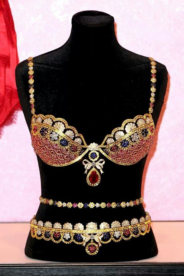 """This Victoria's Secret lingerie set,  is $10 million dollar """"Royal"""" fantasy bra. Created by jeweler Mouawad, the bra features more than 4,200 gems, including rubies, diamonds and sapphires all set in 18 karat gold. The bra also features a pear-shaped center ruby weighing 52 karats."""