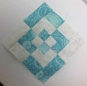 log cabin variation instead of 4 differnt smaller blocks then sewn together start with two blocks with a center sguare and add two rounds of borders. Alternate the colors on the second block.  Cut them in quarters then swap two blocks from each square and sew together.