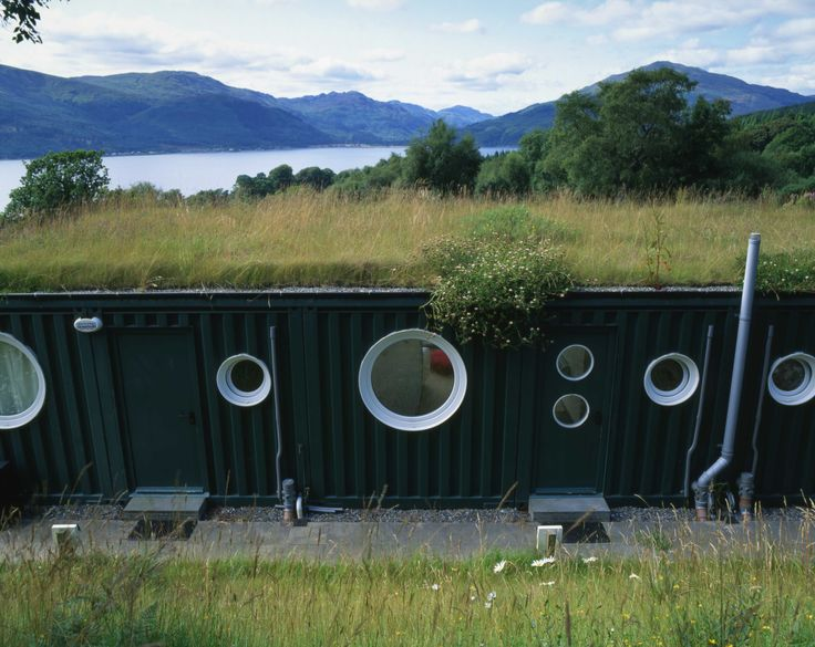 Talk about an amazing location for a shipping container home! The Rosneath-based arts center, Cove Park, overlooks the stunning Loch Long in Scotland, and, since 2002, has had a set of container buildings, known as The Cubes. The first three Cubes housed accommodation units, while another two sets of three were built in 2006, as additional residential and studio units.