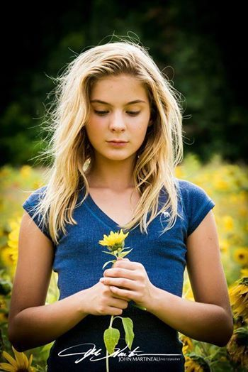 BRIGHTON SHARBINO - ... AND AS HER CHARACTER, IS LOOKING AT THE FLOWER'S.