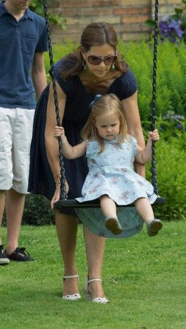 Here you go.... little Princess Josephine is up and swinging with the help of her mother Crown Princess Mary.