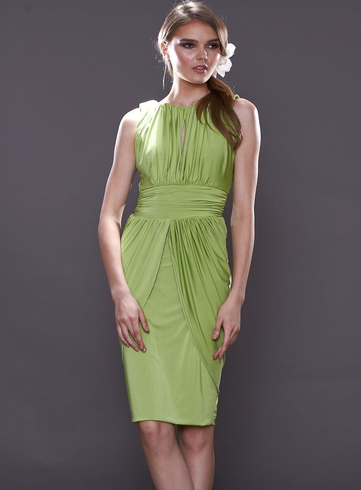 The Kendall Dress by Pia Gladys Perey is a flattering cocktail dress with a keyhole neckline and gathered skirt. Available in Lime.