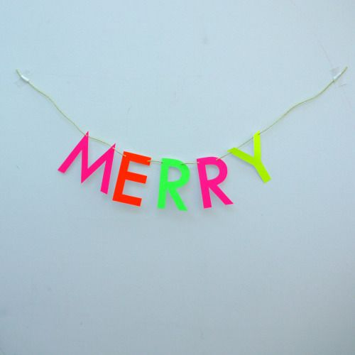 Be MERRY with our bright and bold new Christmas letter banner.  Sometimes you need some neon to cut through that winter darkness!  Luxury handmade paper decor by Paper Street Dolls  Check out our store - paperstreetdolls.etsy.com