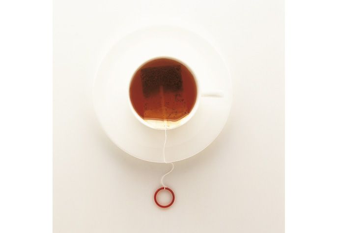 """Naoto Fukasawa's tea bag redesign ~ """" A tea bag with a circle (like a ring) on the end of a string. The ring is the color of perfectly brewed tea. This isn't to tell the user to brew the tea till it turns this color, however; no unsolicited advice is intended here. Fukasawa imagines, though, that as they use the product, people would gradually become conscious of the relationship between the color of tea & that of the ring."""" - Kenya Hara, Designing Design"""