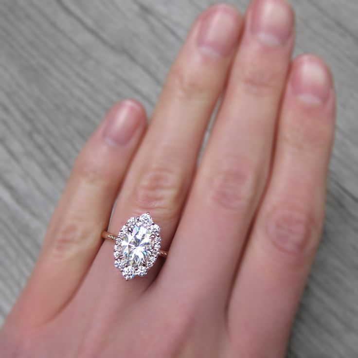 My absolute dream ring. Moissanite is an ethical decision over diamonds. In Rose gold.  Oval Forever One™ Moissanite Engagement Ring with Diamond Halo (2.65ct)