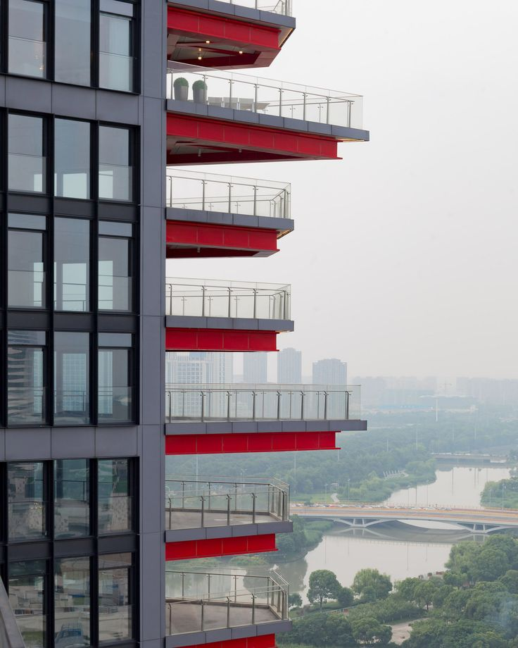 The photographer travelled to the coastal Chinese city, which contains one of the world's biggest ports, to capture the progress of the Rogers Stirk Harbour-designed residential tower complex, Ningbo Gateway, and three Schmidt Hammer Lassen projects: Ningbo Home, Ningbo Daily and Ningbo Library.