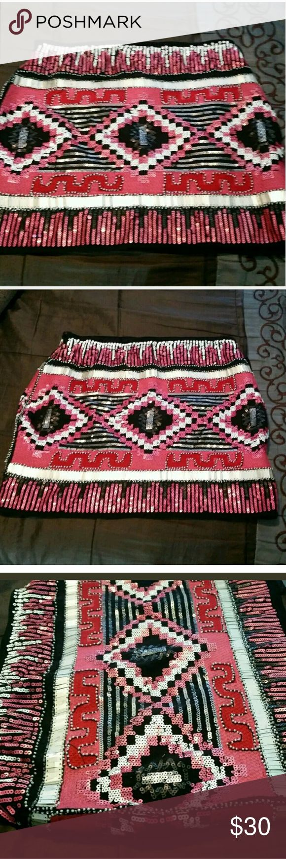 """NWT Forever 21 Fully Sequined Aztec Mini Skirt Forever 21 Womens Skirt Embellished Solid Sequin Aztec Boho Pull On Stretch Mini. Brand new with tags MSRP $45   Type: Skirt Style: Pull On Stretch Mini - Solid Embellishments   Brand: Forever 21 Size: Medium Material: Shell - 95% Polyester 5% Spandex / Lining - 100% Polyester Color: Black Pink Red Multicolor Measurements: Waist - 30"""" / Hips - 36"""" / Length - 30"""" Condition: New with tags  Country of Manufacturer: China Stock Number: 0001 Forever…"""