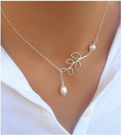 This necklace speaks for the beauty of simplicity and delicacy in style. In silver tone, this necklace has a leaf motif that connects a round pearl on one end and a teardrop pearl on another end. Woul