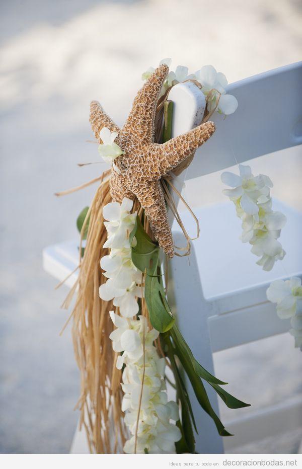 Decoración de sillas en una boda en la playa con estrellas de mar
