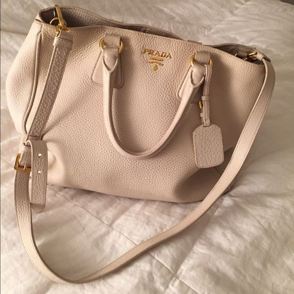 Prada tote Comes with shoulder strap and dustbag. Ivory/white color. Used but good condition. Prada Bags Shoulder Bags
