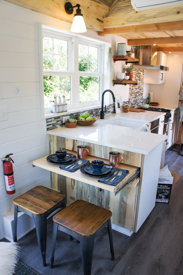 At the end of the kitchen counter is a barstool area with slide out table.