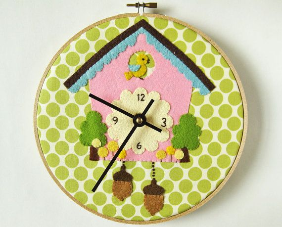Cuckoo Clock - appliqué on olive green polka dots embroidery hoop. $130.00, via Etsy.