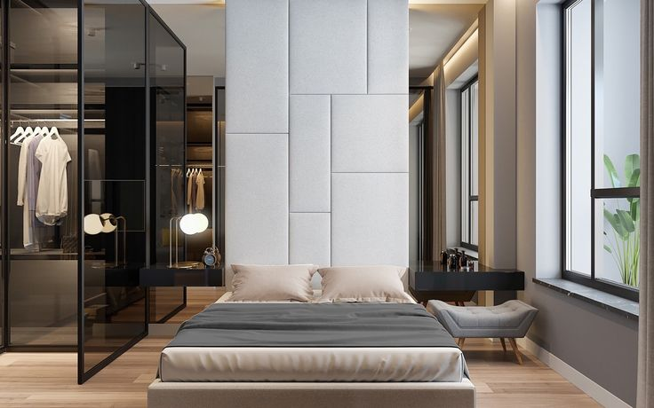 The bedroom uses mirrors to elongate. Mirrors on either side of two feature panels make the space appear open plan. Adding height, the white feature wall mimics square elements in its textures, reflected again in the dark wooden TV panel. Adding length from either side, copper sliding doors let in light from the walk-in wardrobe, while muted bedding offers a rest.