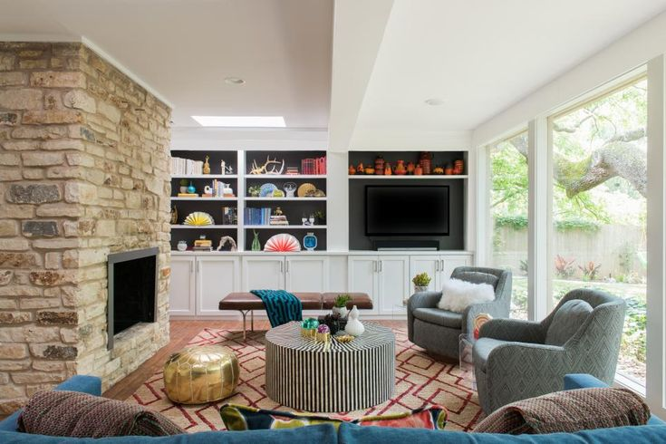 Include flat surfaces, like the striped ottoman and leather bench, in your living room as a kid-level play surface. Built-in bookshelves have closed cabinets below for hidden storage, while starting the open shelves above the reach of little hands allow parents to display favorite pictures, accessories and books.