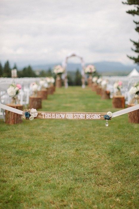 """This is where our story begins"" Wedding aisle :) I really like the stumps that line the aisle with flowers on top."