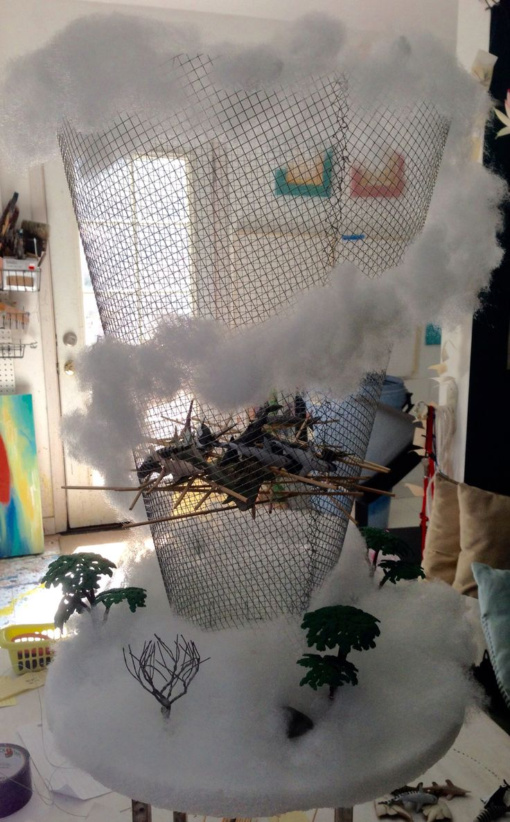"""DIY Sharknado ker-plunk game. Foam disk, 1/4"""" hardware cloth, wire, cotton, toy sharks and wood skewers.  Voila!"""
