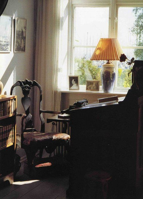 Karen Blixen, aka Isak Dinesen's writing room.  The picture of this room is captivating.  The nuance of light and shadow...it is perfection, save only that I would change the lamp to an amber Victorian style with beaded fringe..