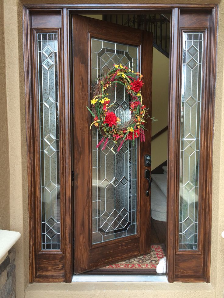 Faux wood front door base coat gold then a coat of minwax gel stain in walnut top with clear for Best stain for exterior wood door