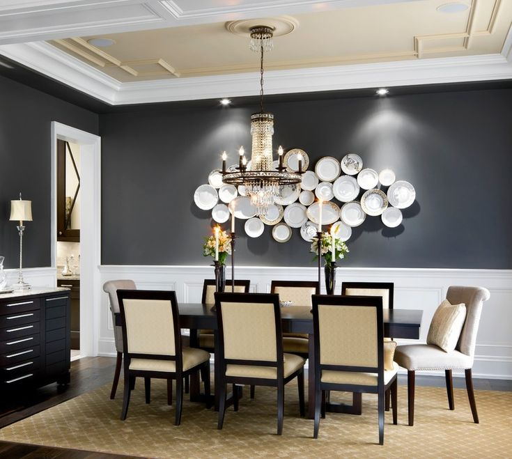 Go for a dark tone. Dining rooms are usually enjoyed with low lighting, and hues like this gray add moody elegance. Note the way the light w...